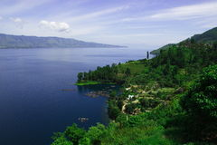 Lake Toba and its beautiful land. In North Sumatra, there is famous large lake namely Lake Toba. It is located in hilly area and its quite buitiful and can be royalty free stock photo