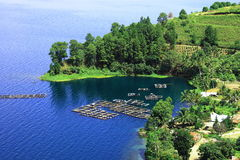 Lake Toba and its Tiny Village. In North Sumatra, there is famous large lake namely Lake Toba. It is located in hilly area and its quite buitiful and can be seen stock photography