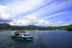Lake Toba and its traditonal boat Stock Photos