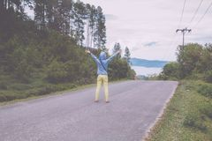 Lake toba, medan, Indonesia. Woman standing on road over Lake toba, medan, Indonesia Royalty Free Stock Photography