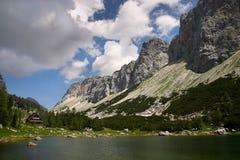 Lake and touristic house on mountain background Royalty Free Stock Photos