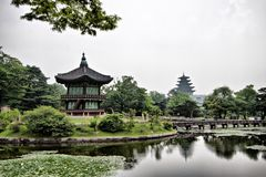 A lake and towers in Changdeogung Palace Royalty Free Stock Photos