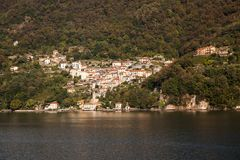 The lake town of Nesso on Lake Como. A delightful, romantic, historic,  lakeside town of Nesso, Italy  spills down the hillside into Lake Como Royalty Free Stock Image