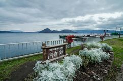 Lake Toya. Cloudy view of the infamous Lake Toya. The lake is a volcanic caldera lake in Shikotsu-Toya National Park, located in Hokkaidō, Japan. The area also Stock Image