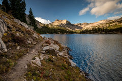 Lake trail leads its perimeter in morning Royalty Free Stock Photography