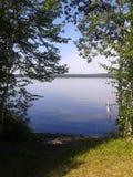 Lake daze. Lake tree shadows royalty free stock image