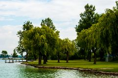 Lake with trees in austria. Lake in Austria with trees in the background green and blue stock photography