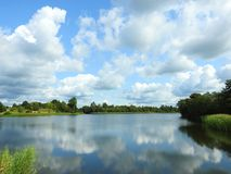 Beautiful trees, lake and nice cloudy sky, Lithuania stock images