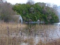 Lake with trees and boathouse. At Killarney County Kerry Ireland Royalty Free Stock Photo