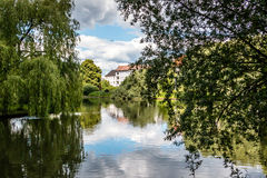 Lake with trees, clouds and house reflection. Lake in Berlin with trees, clouds and house reflection Stock Photo