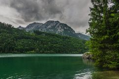 lake with trees and mountains royalty free stock photo