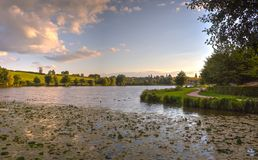 Lake with trees in the sunset Royalty Free Stock Photography
