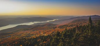 Lake Tremblant at Sunset. Aerial view of beautiful Lake Tremblant at sunset with colorful autumn foliage covering the mountains from the summit of Mont Tremblant Stock Photography