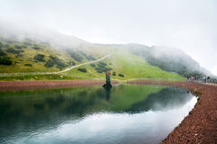 Lake in the Triassic adventure theme park on Steinplatte Mountain in Waidring Stock Photography