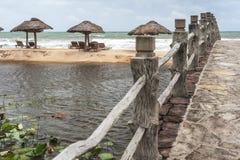 Lake on a tropical beach resort. Lake and a bridge near the sea, at a tropical beach resort Stock Photo