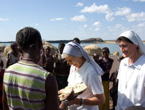 Nuns of Christian church buy handicrafts african tribe Stock Photography