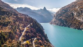 Lake Turquoise Car Mountains Autumn Zervreilasee Switzerland Aerial 4k stock footage