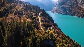 Lake Turquoise Car Mountains Autumn Zervreilasee Switzerland Aerial 4kLake Turquoise Autumn Mountains Zervreilasee Switzerland Aer stock video footage