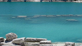 Lake with turquoise waters. Water ripple on the surface of the turquoise reservoir stock video footage