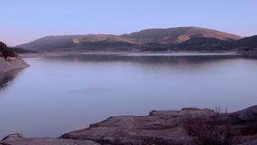 Lake in twilight Stock Photos