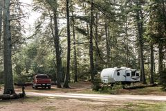 Lake of two rivers Campground Algonquin National Park Beautiful natural forest landscape Canada Parked RV camper car. Lake of two rivers Campground Algonquin Stock Images