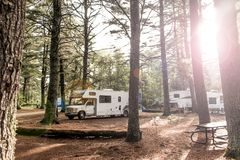 Lake of two rivers Campground Algonquin National Park Beautiful natural forest landscape Canada Parked RV camper car Royalty Free Stock Photo
