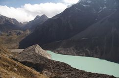 Lake under Alpamayo summit Stock Image