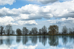Lake under blue cloudy sky Stock Image