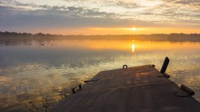 Lake under the gold sky by sunset. Timelapse video stock video footage