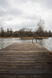Lake under gray rain clouds. Seen from a dock Stock Photo