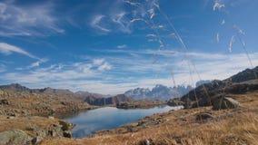 Lake under mountains peaks Royalty Free Stock Photo