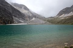 Lake under snow mountain. At height 4300m Stock Photography