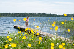 Little girl on the pier at the lake. Little girl walking on the pier at the lake Valdai royalty free stock photography