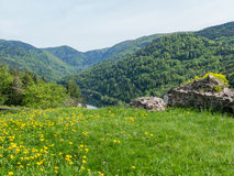 Lake in valley bahind field and ruins Royalty Free Stock Photography