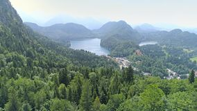 Lake Valley Bavaria Germany Mountains Aerial 4k. Aerial footage of a beautiful lake in the Bavarian alps in Germany. This is in 4k quality stock footage