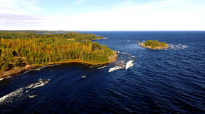 Lake Superior, Aerial View of Island, Woods, Rocky Shoreline. Drone image or birds eye view of Lake Superiro, travel photography aerial shot, large lake with Royalty Free Stock Images