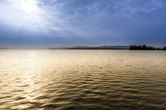 Lake of Varese in a foggy morning Stock Image