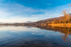Lake Varese, Gavirate. Italy in a beautiful day with blue sky and white clouds Stock Photos