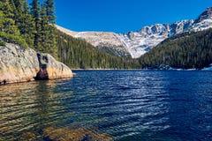 Lake Verna, Rocky Mountains, Colorado, USA. Lake Verna with rocks and mountains around at autumn. Rocky Mountain National Park in Colorado, USA stock photo