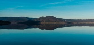 Lake of Vico. Beautiful symmetry after sunset in front of lake of Vico Royalty Free Stock Images