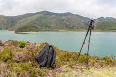 Lake view with backpack and trekking poles stock images