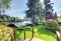 Lake view backyard with deck and spring landscape. Stock Image