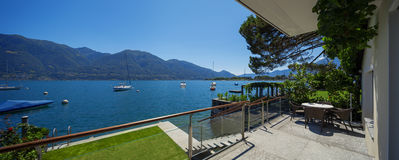Lake view from the balcony of modern villa, summer Royalty Free Stock Image