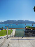 Lake view from the balcony of modern villa, summer Stock Image