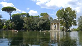 Lake in the Villa Borghese Park in Rome. Lake view with boats in the Villa Borghese Park in Rome stock video footage