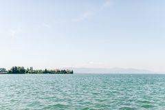 Lake view of the bodensee in Germany. Landscape view of the bodensee near Lindau Germany. Water as far as you can look, and mountains behind it Stock Images
