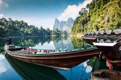 Lake View, Khao Sok National Park. Long-tail boat and lakeside raft houses on Cheow Lan Lake, Khao Sok National Park in southern Thailand Stock Photo