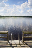 Lake view with ladders from the pier Royalty Free Stock Photography