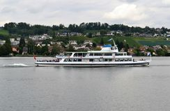 Limmet River cruiser pass-by, Lake view Royalty Free Stock Image