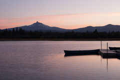 Lake view at sunset with mountains Royalty Free Stock Images